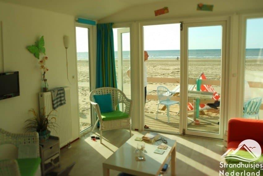 Katwijk aan Zee interieur Key west met tv en 2 fauteuils..