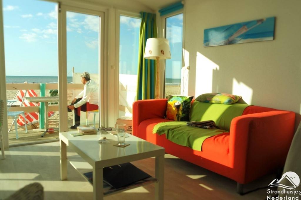 https://strandhuisje.nl/upload/2016/05/Vrolijk-interieur-strandhuisjes-Katwijk-aan-Zee-Key-West....jpg