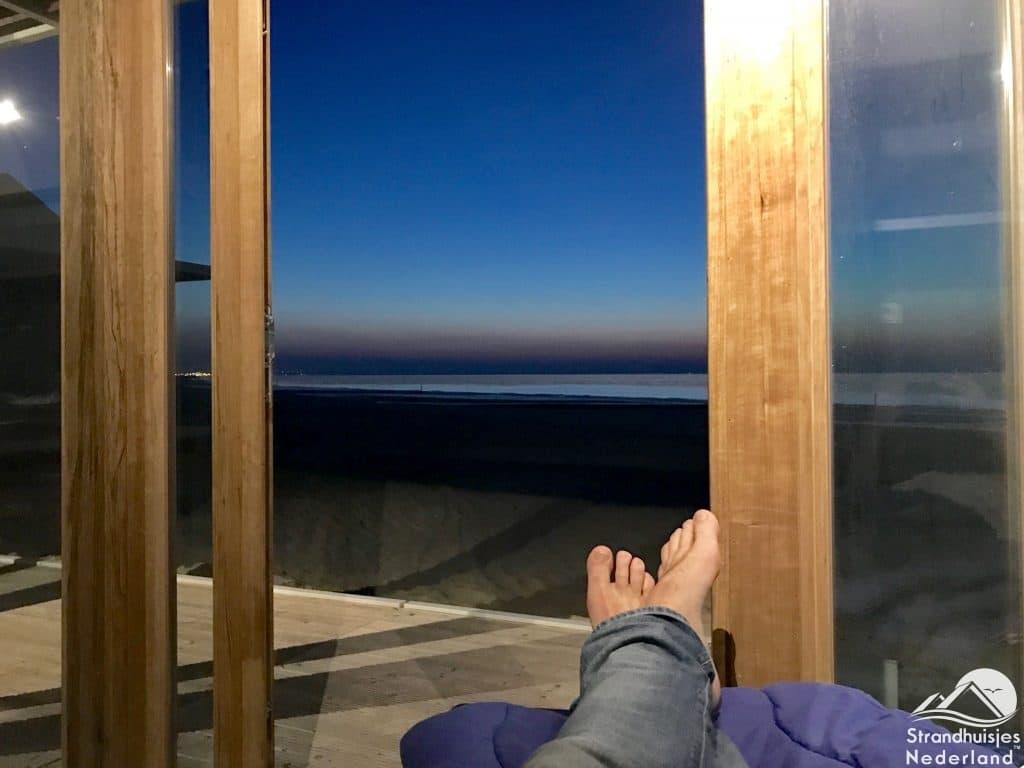 Uitzicht slaapkamer strandhuisje Cadzand