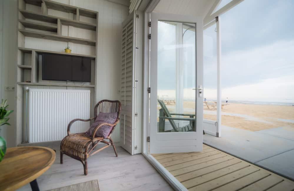 Zicht op de Noordzee - Strandhuisje SandCsleep Katwijk